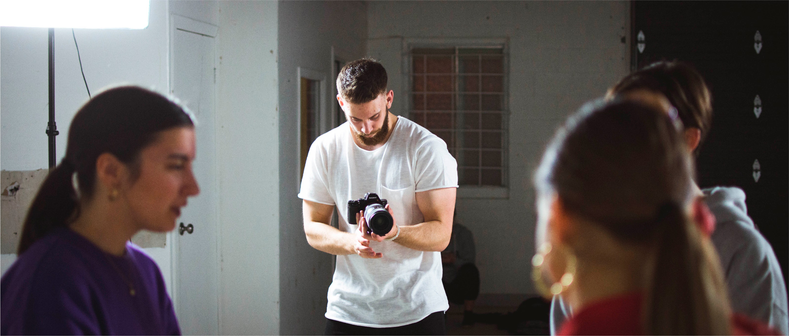 Man filming a group of people